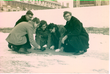 The Cambridge University Tiddlywinks Club playing winks on the frozen river Cam (early 1960s).