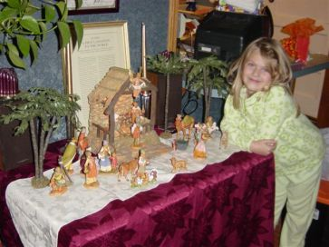 Rachel at about five years-old with our Nativity creche