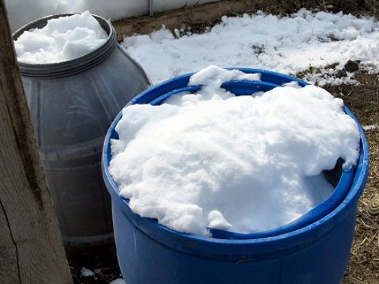 Melting snow in water barrels