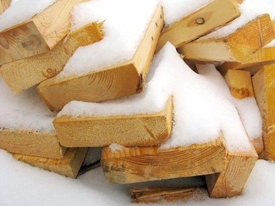 New snow on scrap wood