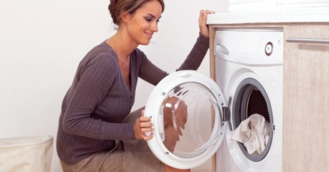 WomanKneelingbyWasher
