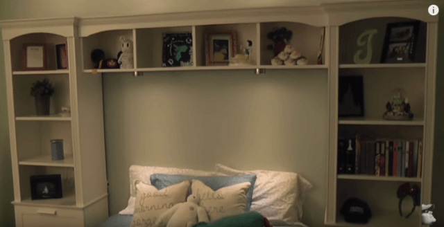 Frame bed with Ikea shelves for more storage without losing space