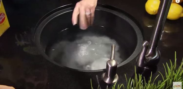 Baking soda and hot water cleans smelly garbage disposal