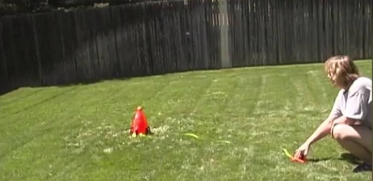 This adorable dog fetches a water rocket right out of the air
