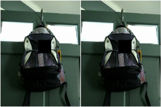 Hang backpacks from Dollar Store wreath hooks