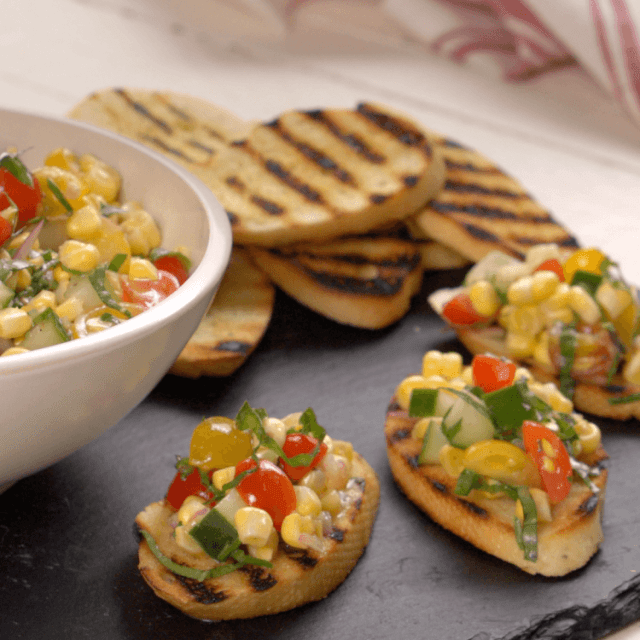 Corn and tomato relish on slices of toasted bread