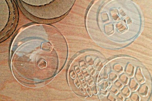 Acrylic cut by laser cutter into mason jar lids