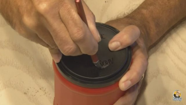 Cut a smooth circular hole in the lid of the coffee can