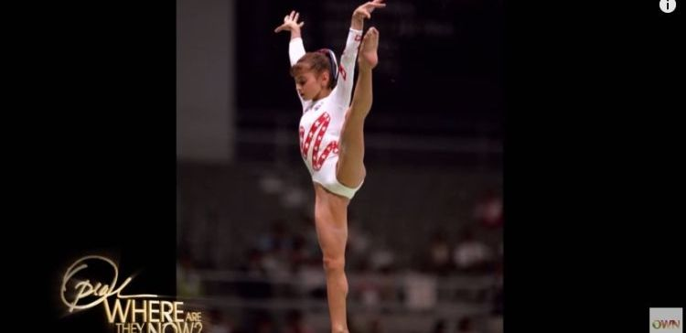Dominique Moceanu performing gymnastics during 1996 Olympics