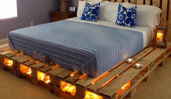 Bed made out of repurposed pallets with under-bed LED lights