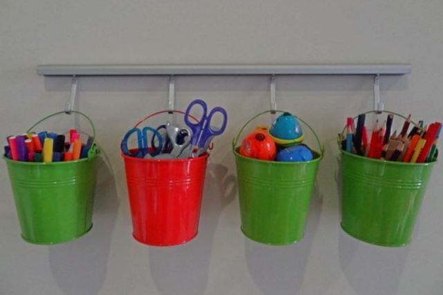 Use Dollar Store buckets on hooks to store school supplies