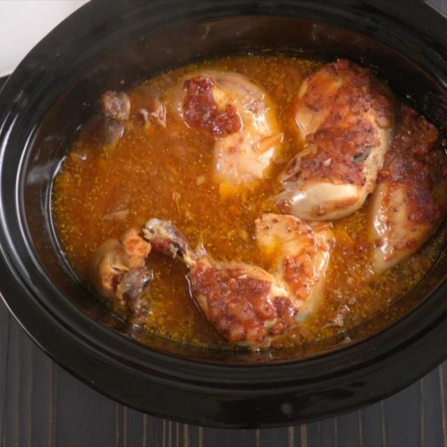 Zesty BBQ chicken cooking in slow cooker