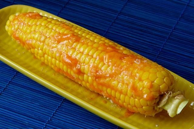 Corn on the cob coated in Sriracha butter
