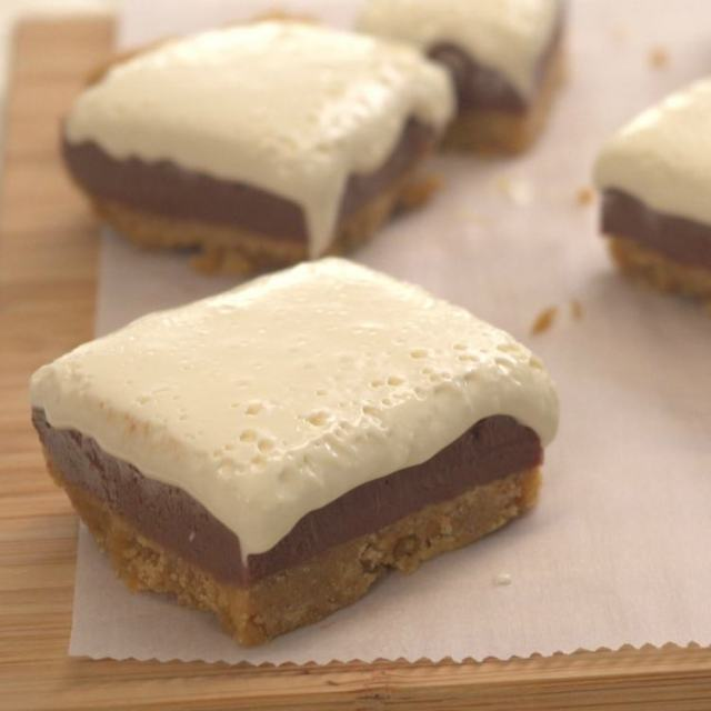 Squares of s'mores fudge on parchment paper