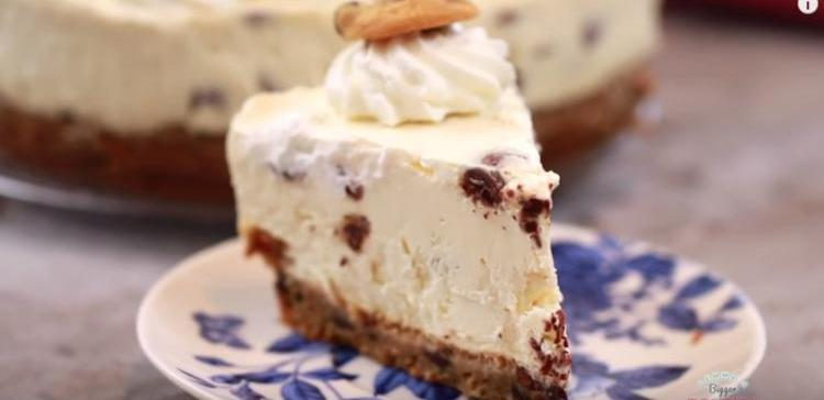 Slice of chocolate chip cookie cheesecake with cookie crust