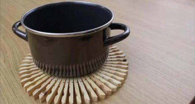 Large pot holder made from clothespins.
