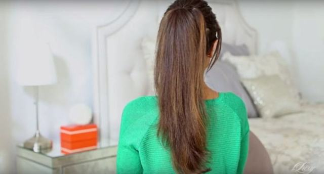 Two ponytails blended together to create 1 big long one
