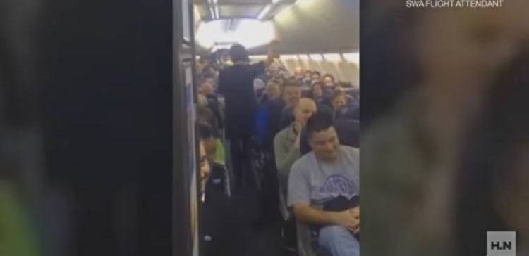 Southwest flight attendant does a stand up routine.