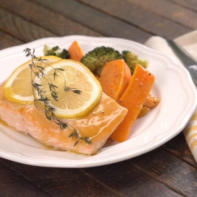 Honey glazed sheet pan salmon on white plate