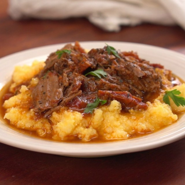 Plate of Italian-style pot roast and mashed potatoes