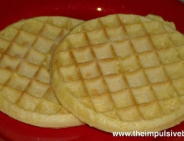 two waffles on a red plate