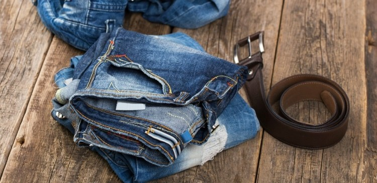 Pictured of worn jeans with belt.