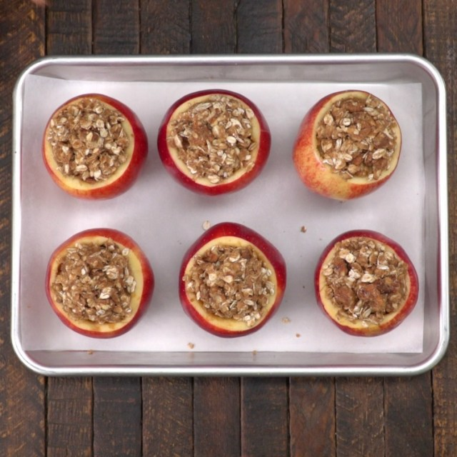 Stuffed apples on sheet tray to bake