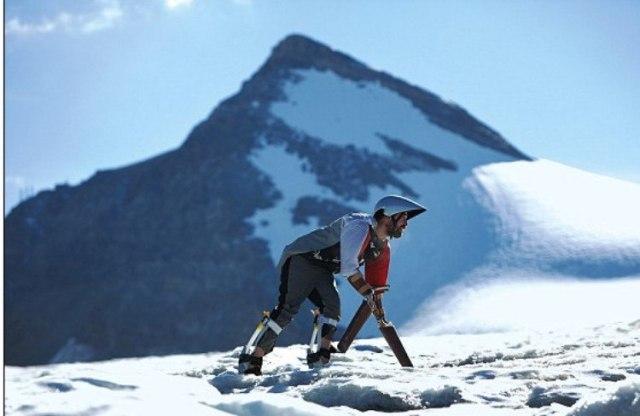 goat man climbing up mountain