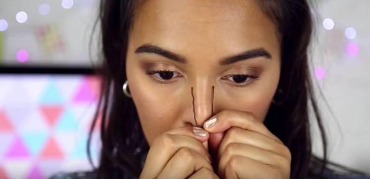 girl pinching nose with bobby pin