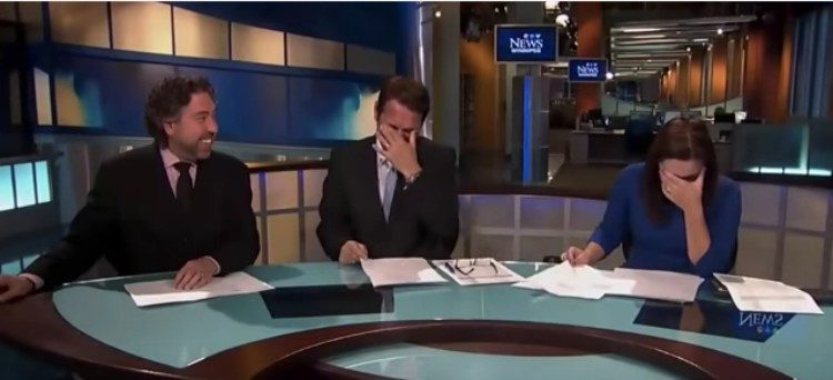 reporters laughing at anchor desk