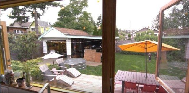 view of the backyard through large windows