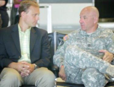 Brad and Glascott speak at the airport