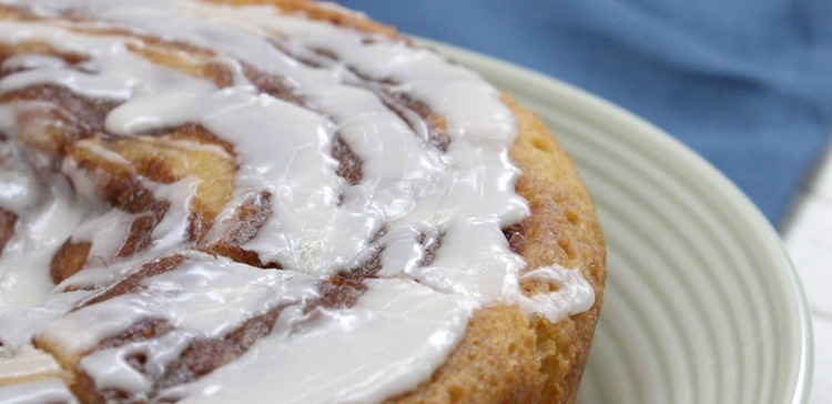 Close-up of cinnamon roll cake on a white plate