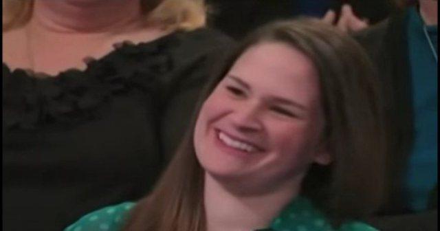 Jackie smiling in audience