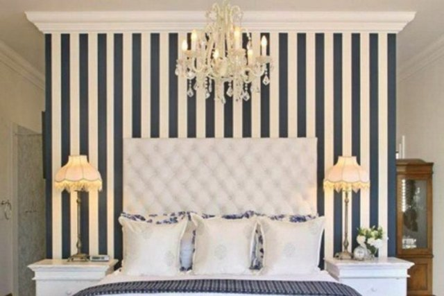 Use vertical stripes to elongate walls and ceiling