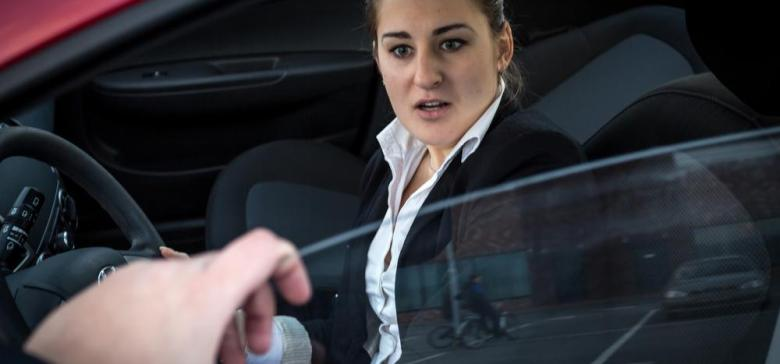 Burglar threatens businesswoman sitting in car