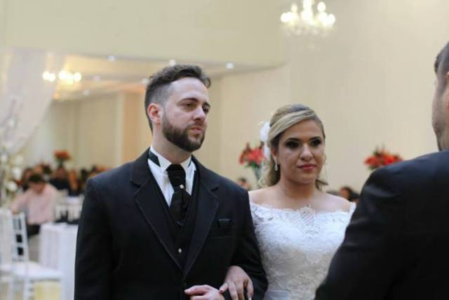 Diogo and Nicole stand at altar during wedding