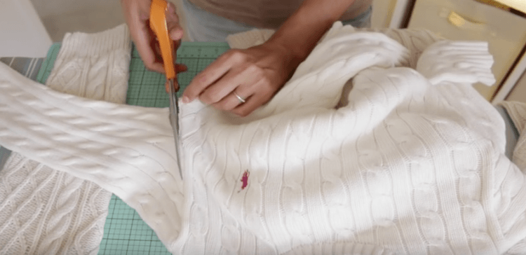 Image of sweater being cut up.