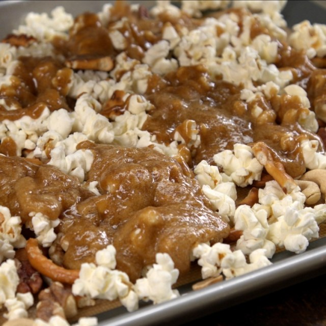 Drizzle caramel mixture over the popcorn mixture
