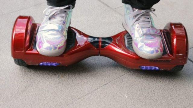 Someone riding a red hoverboard.