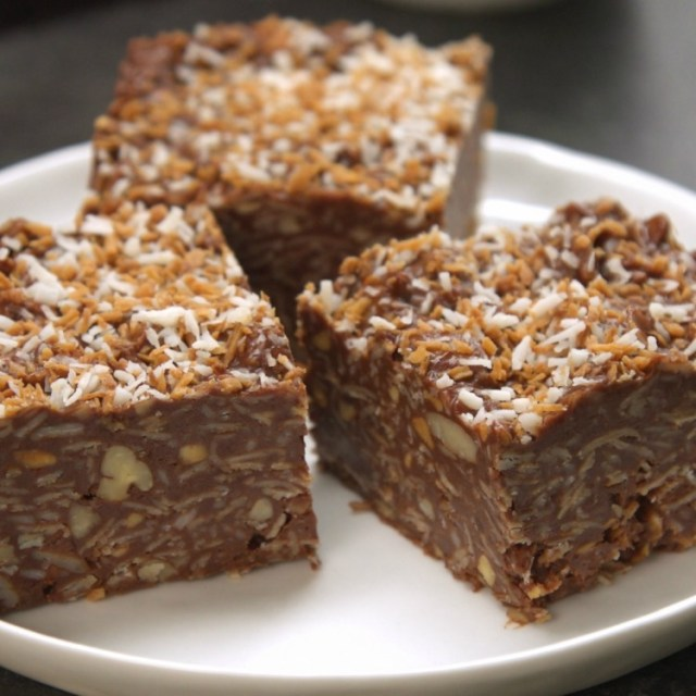 No-bake peanut butter chocolate coconut bars on white plate