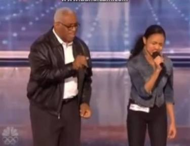 Image of father and daughter on stage.