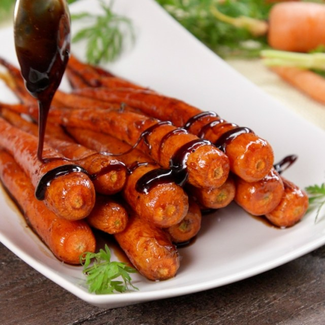 Drizzling roasted carrots with honey balsamic glaze
