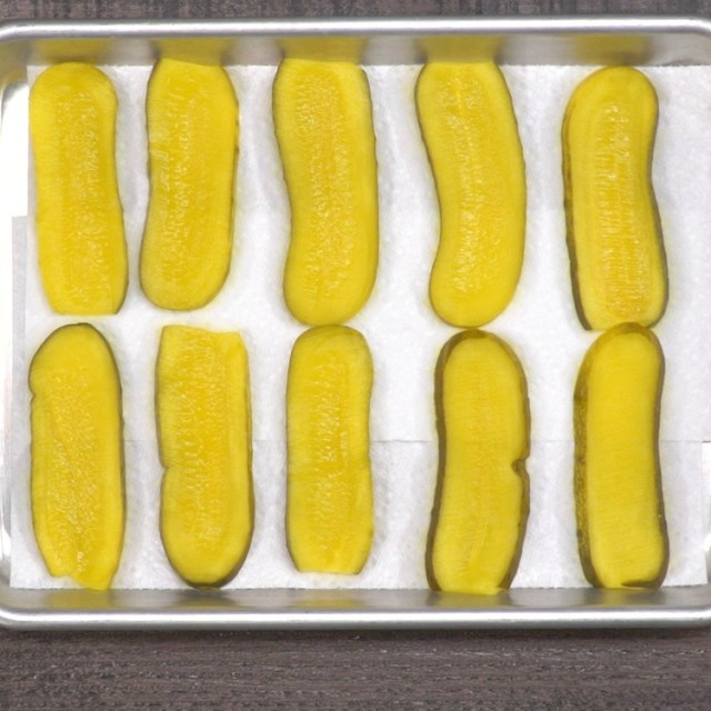 Place pickle slices on paper towels or kitchen towels and pat to dry