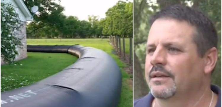 Image of man and inflatable dam.