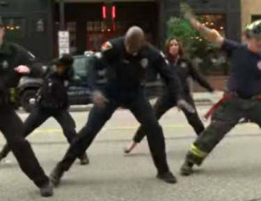 first responders dancing on the street