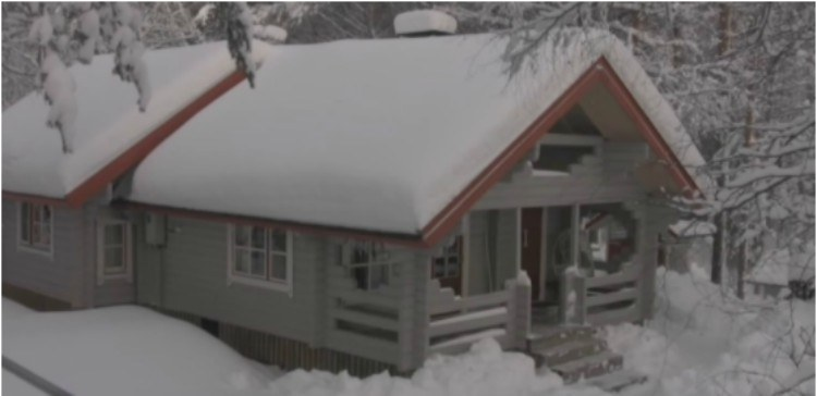 exterior of a home surrounded by snow