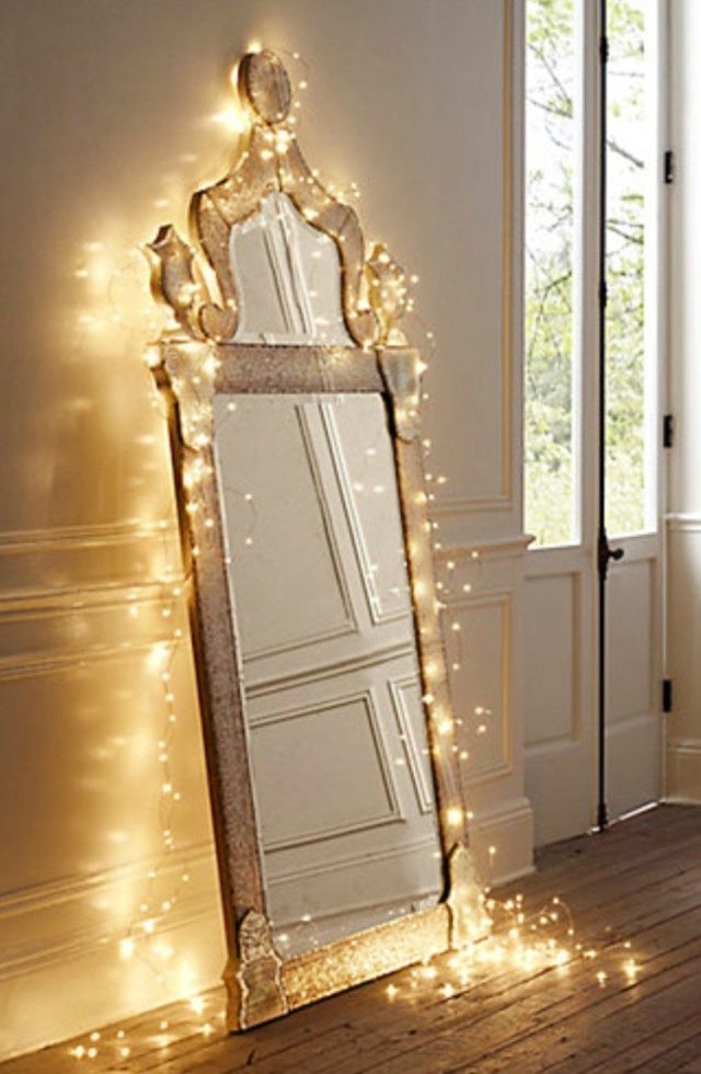 Mirror draped in fairy lights.