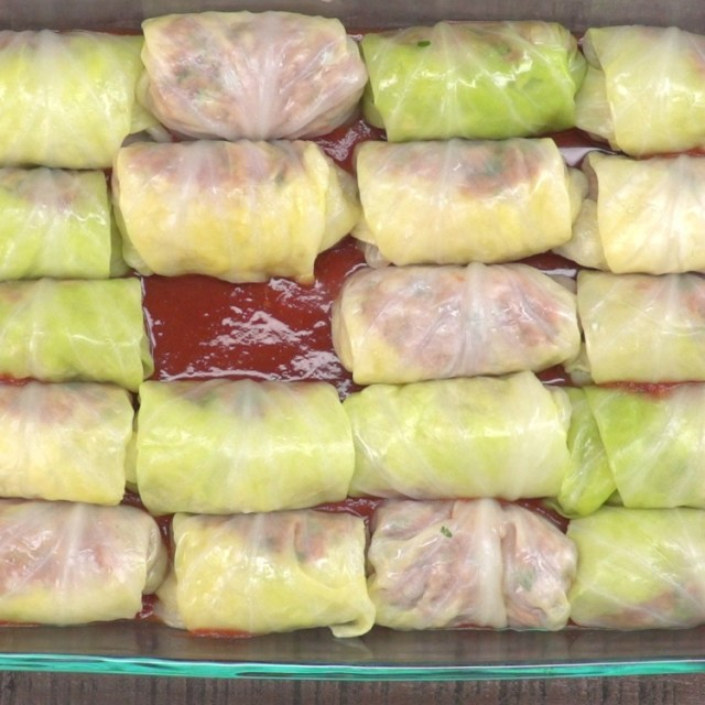 Place cabbage rolls in the prepared baking dish, seam side down