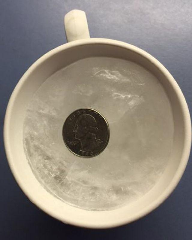 Facebook post of quarter on frozen water.